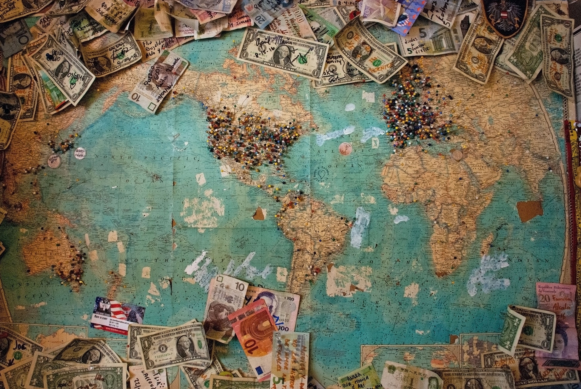 Map of the world with bills of different countries. The Morning Walk Paris guided tours